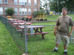 Picture of Daniel Wolf in front of completed playground