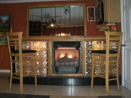 "Glass blocks from the Forklift are the ""bookends"" for a home bar with a natural gas fireplace."