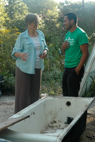Community Forklift donor Joy Melnick, who lives in the College Park neighborhood of Calvert Hills, talks with donations team member Ulises Solozano.