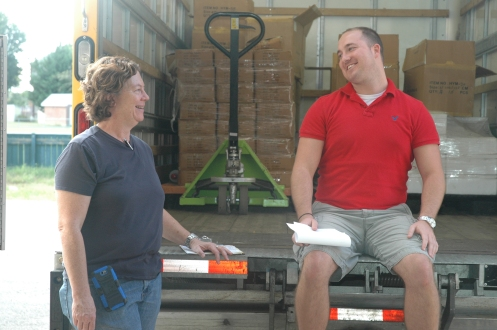 Nancy Meyer, Community Forklift's chief executive officer, makes sure John Gray receives the right paperwork for a donation made by Wholesalers USA Inc.