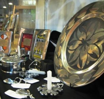 AFTER: The metal is turned into platters, candle holders, keychains, belt buckles, and many more great gift items.