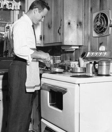 man at stove vintage