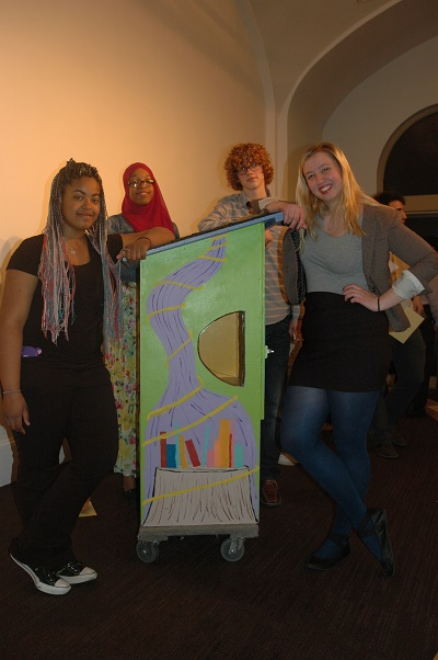 Left to right, Yasmeen Webb, Amara McKinney, Luca Bilke and Evangelina Hakes show how they blended the books and garden theme on one side of their Little Free Library.