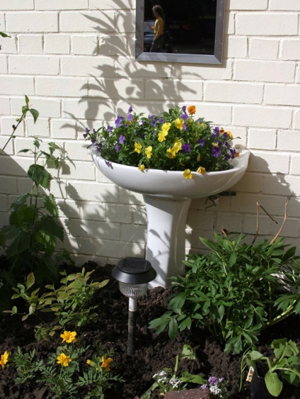 Don't need a new bathroom sink?  Pedestal sinks also make cute planters, like this one from