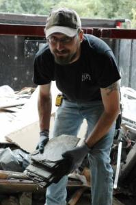 Doug Utterback unloads roofing slate from a truck at the Forklift's Bay 3.
